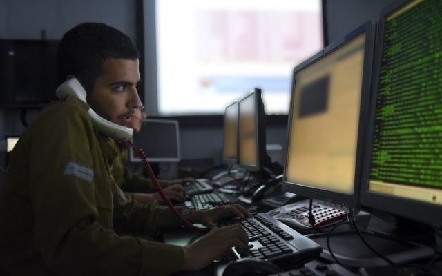 Illustrative. An IDF soldier from the C4I Corps types on a computer. (IDF Spokesperson's Unit)