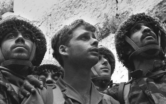 From left, Israeli paratroopers Tzion Karasenti, Yitzhak Yifat and Chaim Oshri standing at the Western Wall after Israel captured the Temple Mount in Jerusalem, June 7, 1967. (David Rubinger/GPO)