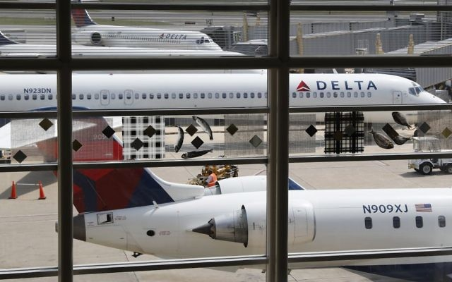 Illustrative image of Delta Air Lines planes parked at Ronald Reagan Washington National Airport, in Washington, Aug. 8, 2016. (AP Photo/Carolyn Kaster)