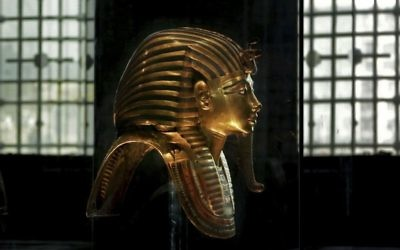 In this Oct. 30, 2013 photo, the solid gold mask of King Tutankhamun is seen in its glass case, in the Egyptian Museum near Tahrir Square in Cairo, Egypt.  (AP Photo/Nariman El-Mofty)