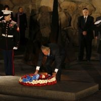 US President George W Bush lays a wreath in memory of the six million Jewish Holocaust victims in the Hall of Remembrance at the Yad Vashem Holocaust museum in Jerusalem, 11 January 2008. (Michal Fattal/Flash90)