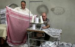 Palestinian men working in a keffiyeh factory in the West Bank city of Hebron on October 14, 2010. (Najeh Hashlamoun/Flash90)