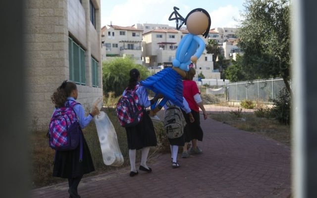 Ultra-Orthodox girls go to school in Beit Shemesh on September 1, 2014 (Nati Shohat/Flash90)