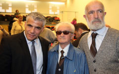 Yesh Atid Chairman Yair Lapid (left), at the Holot Institute of Technology for the Holocaust Survivors Conference on December 29, 2014. (Flash90)