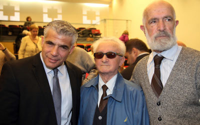Illustrative: Yesh Atid Chairman Yair Lapid (left), at the Holot Institute of Technology for the Holocaust Survivors Conference on December 29, 2014. (Flash90)