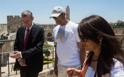Tourism Minister Yariv Levin (l) walks in Jerusalem's Old City with former New York Yankees professional baseball pitcher Mariano Rivera (C) on June 18, 2015. (Yonatan Sindel/Flash90)
