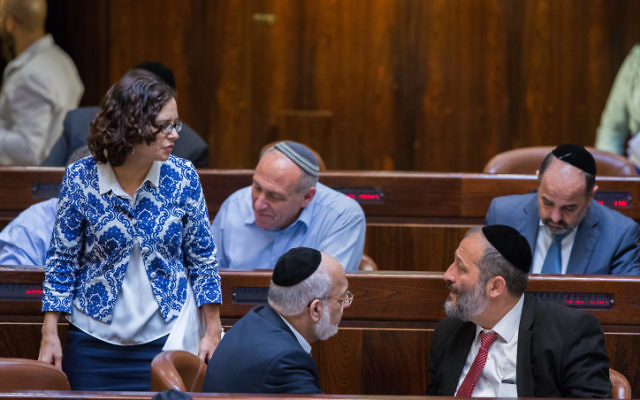 Interior Minister Aryeh Deri (R) speaks with Kulanu MK Rachel Azaria (L) during a plenum session in the assembly hall of the Israeli parliament on July 15, 2015. (Yonatan Sindel/Flash90)