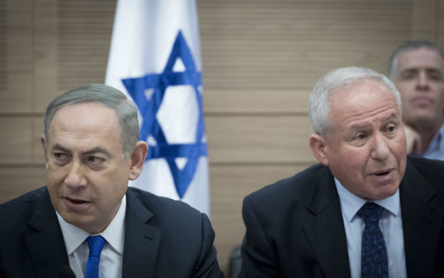 Prime Minister Benjamin Netanyahu and Head of the Defense and Foreign Affairs Committee Avi Dichter attend a Knesset Foreign Affairs and Defense Committee meeting at the Knesset, on March 8, 2017. (Yonatan Sindel/Flash90)