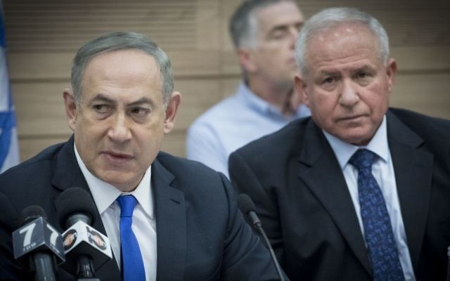 Prime Minister Benjamin Netanyahu, left, and Head of the Defense and the then Foreign Affairs Committee MK Avi Dichter in the Knesset, March 8, 2017. (Yonatan Sindel/Flash90)