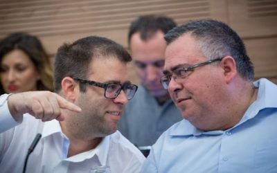 Likud parliament members Oren Hazan and David Bitan attend a committee meeting in Knesset on March 15, 2017. (Miriam Alster/Flash90)