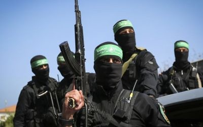 Masked Hamas terrorists attend the funeral of Mazen Fuqha in Gaza City, March, 25 2017. (Abed Rahim Khatib/Flash90)