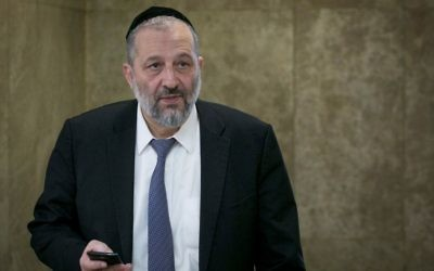 Interior Minister Aryeh Deri arrives to the weekly cabinet meeting at the Prime Minister's Office in Jerusalem on April 9, 2017. (Ohad Zwigenberg/Pool)