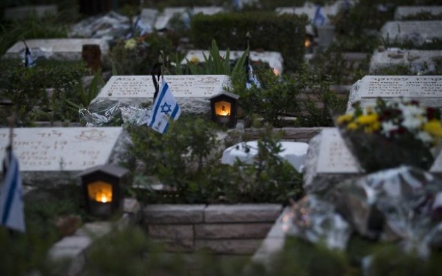 Memorial candles near graves of fallen soldiers at Mount Herzl Military Cemetery in Jerusalem, on April 30, 2017.  (Yonatan Sindel/Flash90)
