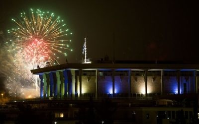 Fireworks from the Mount Herzl ceremony seen over the Knesset in Jerusalem, marking the beginning of celebrations of Israeli 69th Independence Day, on May 1, 2017. (Yonatan Sindel/Flash90)