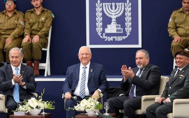 From left to right: Prime Minister Benjamin Netanyahu, President Reuven Rivlin, Defense Minister Avigdor Liberman and IDF Chief of Staff Gadi Eisenkot at an Independence Day ceremony at the President's Residence in Jerusalem on May 2, 2017. (Hadas Parush/Flash90)