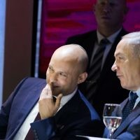 Education Minister Naftali Bennett, left, speaks with Prime Minister Benjamin Netanyahu, right during the Israel Prize award ceremony at the International Conference Center (ICC) in Jerusalem on May 2, 2017. (Yonatan Sindel/Flash90)