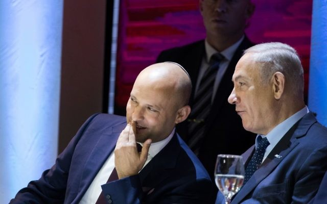 Education Minister Naftali Bennett speaks with Prime Minister Benjamin Netanyahu during the Israel Prize ceremony at the International Conference Center (ICC) in Jerusalem on May 2, 2017. (Yonatan Sindel/Flash90)