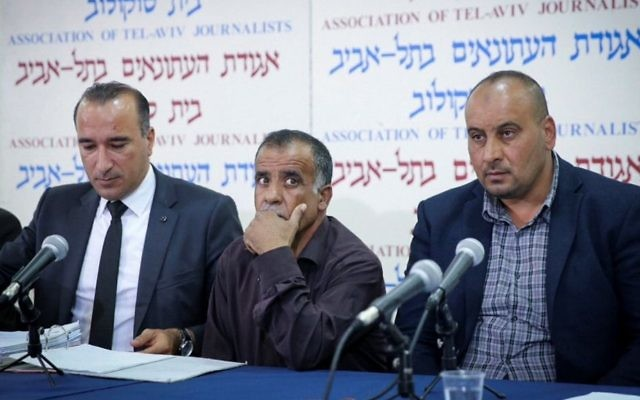Members of the Dawabsha family speak at a press conference in Tel Aviv announcing their decision to sue the State of Israel on May 8, 2017. (Flash90)