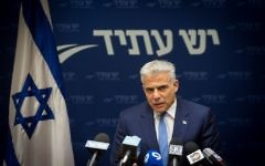 Yesh Atid party leader Yair Lapid leads a faction meeting in the Knesset on May 8, 2017. (Miriam Alster/FLASH90)