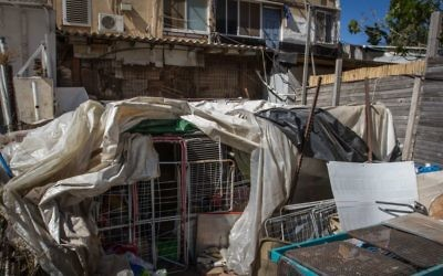 The outdoor cage at an apartment where a 14-year-old has been allegedly kept in solitude  by his parents in Hadera, seen on May 11, 2017.  (Flash90)