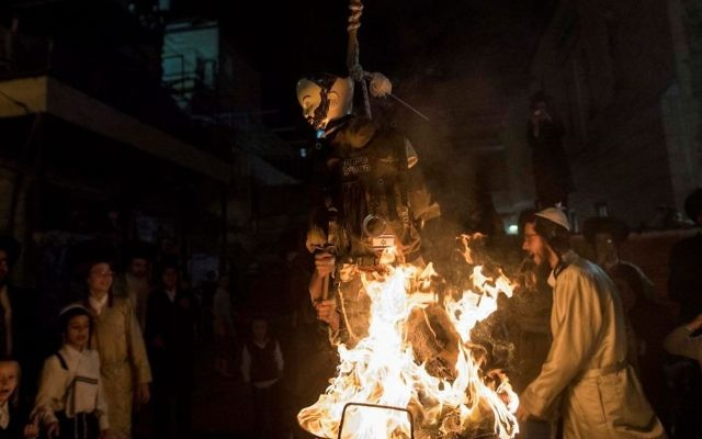 Ultra-Orthodox Jews burn an effigy of an IDF soldier during Lag B'Omer celebrations in the ultra-orthodox neighborhood of Mea She'arim in Jerusalem on May 13, 2017. (Noam Revkin Fenton/Flash90)