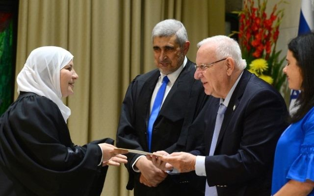Justice Minister Ayelet Shaked, President Reuven Rivlin, and President of the Shariya Court of Appeals, the Qadi Abed Alhakim Samara, give a certificate to the newly appointed first female Qadi, Hana Mansour Khatib at the president's residence, on May 15, 2017. (Mark Neyman/GPO)