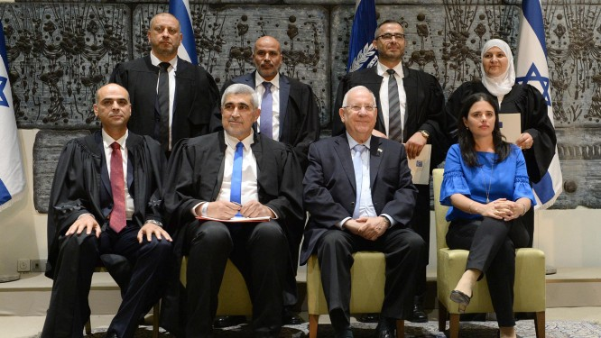 New qadis, or religious judges, pose for a picture at the President's residence, on May 15, 2017 with President Reuben Rivlin and Justice Minister Ayelet Shaked. (Mark Neyman/GPO)
