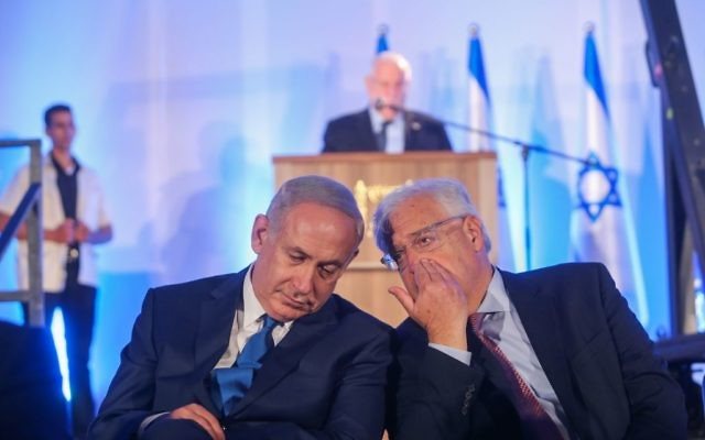 Prime minister Benjamin Netanyahu, left, speaks with new US Ambassador to Israel, David Friedman during a ceremony marking the 50th anniversary of Jerusalem's reunification,  May 21, 2017. (Alex Kolomoisky/POOL)