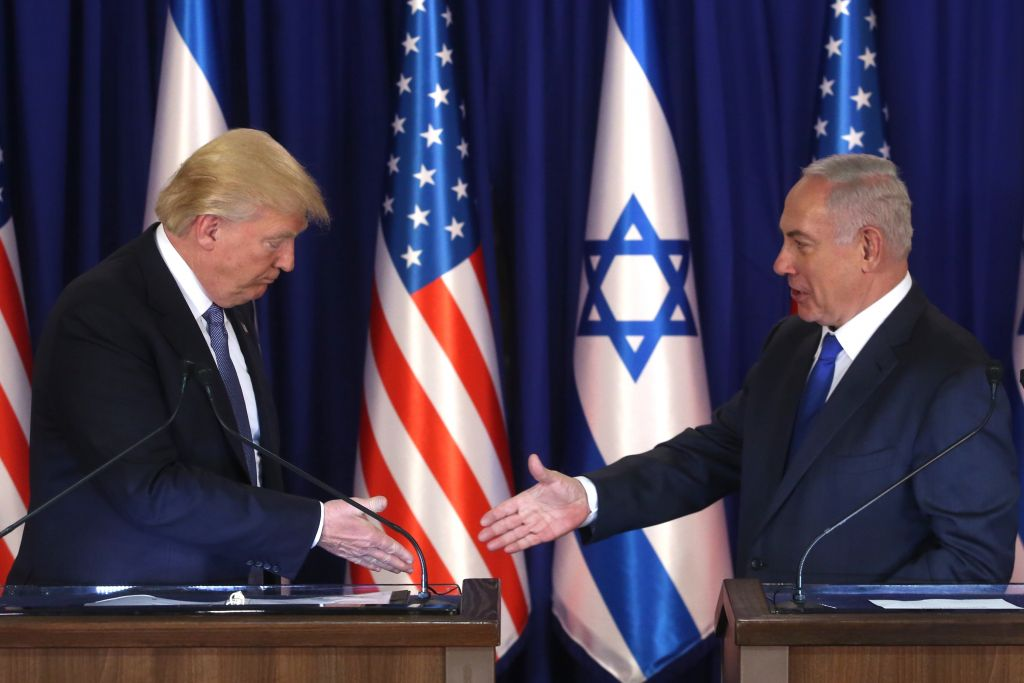US President Donald Trump and Israel's Prime Minister Benjamin Netanyahu shake hands after delivering press statements prior to an official dinner in Jerusalem on May 22, 2017. (Marc Israel Sellem/POOL)
