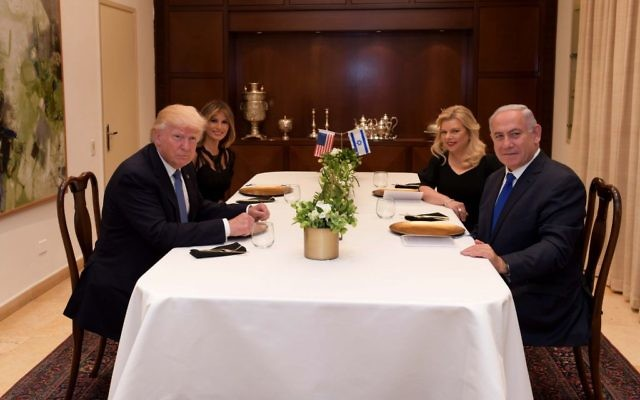 Prime Minister Benjamin Netanyahu, right, and his wife Sara, second right, host US president Donald Trump, left, and his wife Melania at the Prime Minister's Residence in Jerusalem, May 22, 2017. (Avi Ohayon/GPO)