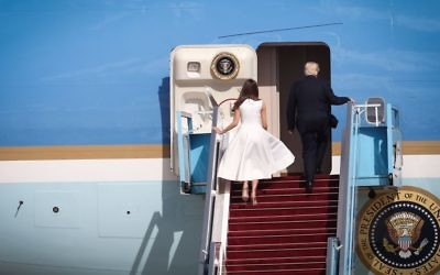 US President Donald Trump his wife Melania walk up the steps to Air Force One ahead of their departure from Israel at Ben Gurion International Airport in Tel Aviv on May 23, 2017 (Miriam Alster/Flash90)