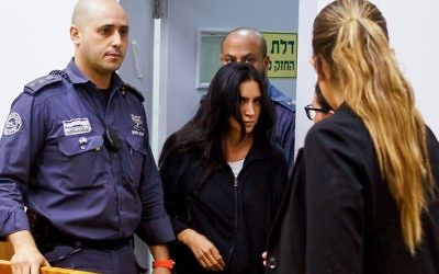 Karin Abutbul (c), the wife of Asi Abutbul, head of the crime family in Netanya, seen at the court in Rishon LeZion after being arrested in connection to the murder of Moses Hadas in 2000. May 28, 2017. (Flash90)