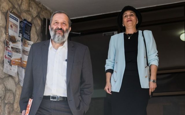 Interior Minister Aryeh Deri (l) and his wife Yaffa seen leaving their home in Jerusalem, on May 29, 2017. (Yonatan Sindel/Flash90)