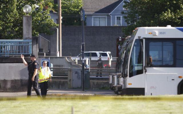 Police investigate a deadly stabbing on a Metropolitan Area Express train in northeast Portland, Oregon, May 26, 2017. (Jim Ryan/The Oregonian via AP)