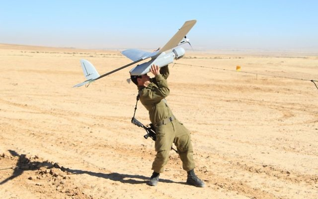 Illustrative: An IDF soldier from the Artillery Corps launches an Elbit Skylark drone, known in the IDF as a Sky Rider, on January 21, 2013. (Cpl. Zev Marmorstein/Israel Defense Forces)