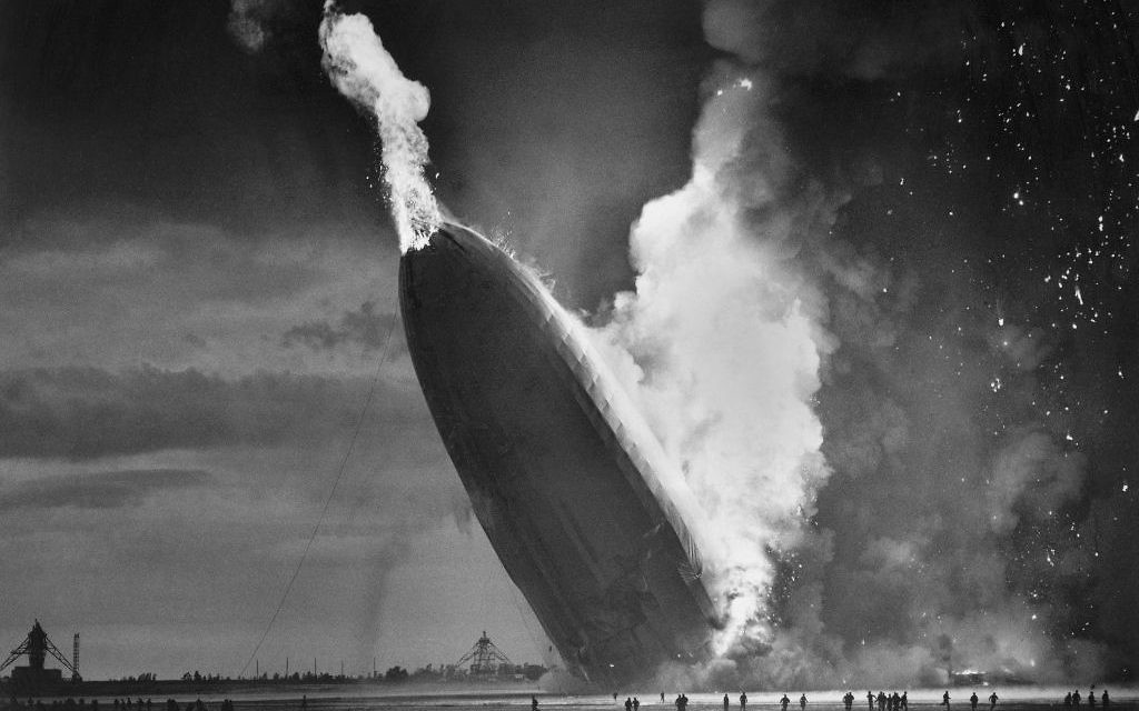 In this May 6, 1937 photo, the German dirigible Hindenburg crashes to earth in flames after exploding at the U.S. Naval Station in Lakehurst, N.J.  (AP Photo/Murray Becker, File)