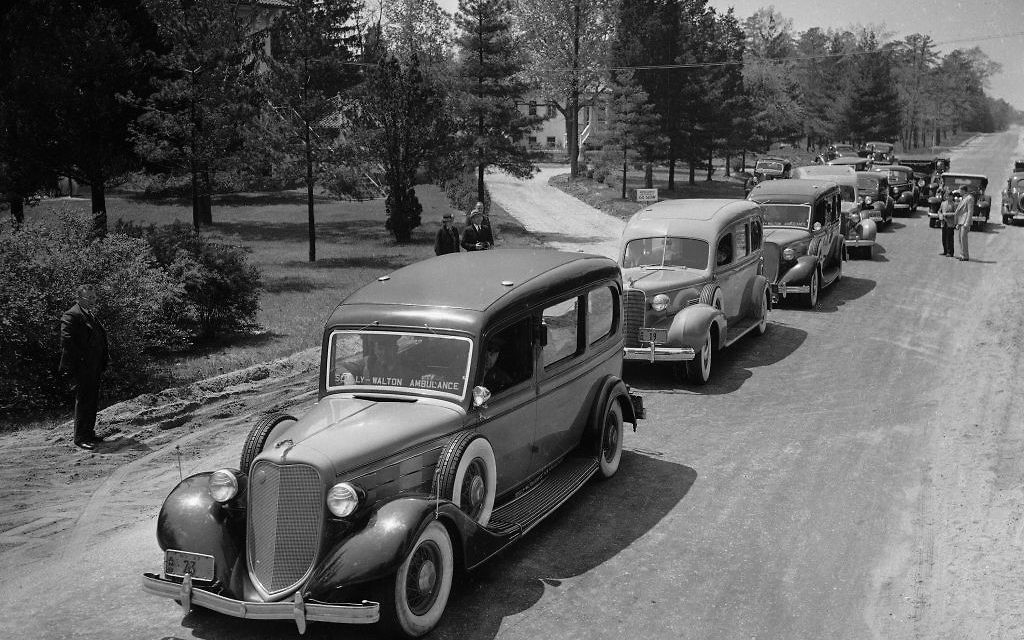 In this May 7, 1937 photo, ambulances line up to transfer hospitalized victims of the Hindenburg disaster the previous day to other area hospitals from Paul Kimball Hospital, in Lakewood, N.J. (AP Photo, File)
