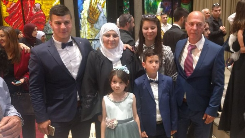 Hana Mansour Khatib, the first female qadi, or religious judge, with her family at her installation ceremony at the presidential residence in Jerusalem on May 15, 2017. (Melanie Lidman/Times of Israel)