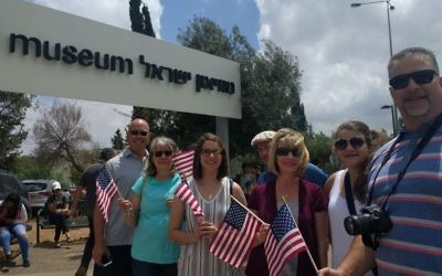 Trump supporters from Missouri and Texas, including Susan Anderson, second from left, and Misty Frost, third from right, outside the Israel Museum waiting for a glimpse of the Trump motorcade on May 22, 2017. (Melanie Lidman/Times of Israel)