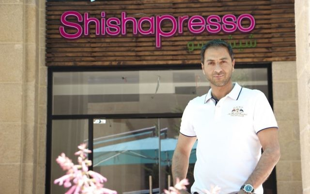 Murad Howari, founder of the Shishapress cafe chain, is the first Palestinian entrepreneur to own a shop in the Rawabi Q Center. (Dov Lieber / Times of Israel)