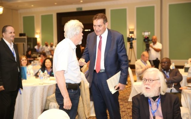 Khaled Toukan, the chairman of the Jordan Atomic Energy Commission and director of SESAME talks with Former CERN director Rolf-Dieter Heuer at the Sharing Knowledge Foundation Conference at the Dea Sea, Jordan, on May 12, 2017. Heuer is slated to become the President of the Council of SESAME. (Sharing Knowledge Foundation)