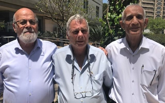 Tzion Karasenti, left, Yitzhak Yifat and Chaim Oshri standing on the Tel Aviv University campus, Ramat Aviv, Israel, May 7, 2017. (Andrew Tobin)
