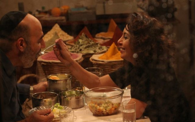 Loving husband and wife Zion (Igal Naor) and Ettie (Evelin Hagoel) share an evening meal together in 'The Women's Balcony.' (Menemsha Films)