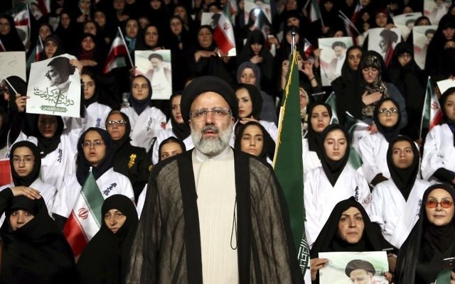 Iranian cleric and presidential candidate Ebrahim Raisi, center, stands among his supporters, during a campaign rally in Tehran, Iran, April 29, 2017. (AP/Ebrahim Noroozi)