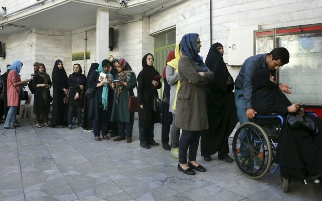 Iranian voters queue at a polling station for the presidential and municipal council election in Tehran, Iran, Friday, May 19, 2017. (AP Photo/Vahid Salemi)
