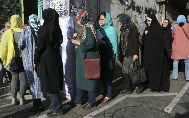 Iranian voters enter a polling station for the presidential and municipal councils elections in Tehran, Iran, Friday, May 19, 2017. (AP Photo/Vahid Salemi)