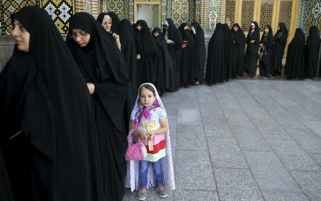 Iranian women queue to vote for the presidential and municipal councils elections, in the city of Qom, south of the capital Tehran, Iran, Friday, May 19, 2017. (AP Photo/Ebrahim Noroozi)