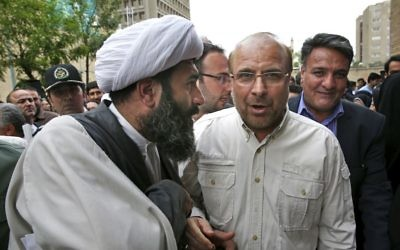 Tehran's mayor and conservative presidential candidate Mohammad Bagher Qalibaf, center right, listens to a cleric on his arrival to attend a campaign rally in Tehran, Iran, May 2, 2017. (AP/Vahid Salemi, File)