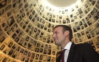 In this file photo dated Sunday, Sept. 6, 2015, French Minister of Economy, Industry and Digital Affairs Emmanuel Macron, visits the Hall of Names at the Yad Vashem Holocaust Memorial in Jerusalem. (Sebastian Scheiner/AP)
