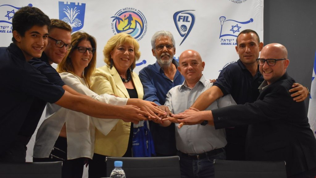 Netanya Mayor Mariam Feirberg-Ikar (C-L) and ILA head Scott Neiss (3rd-R) accompanied by Team Israel lacrosse players. (Courtesy)